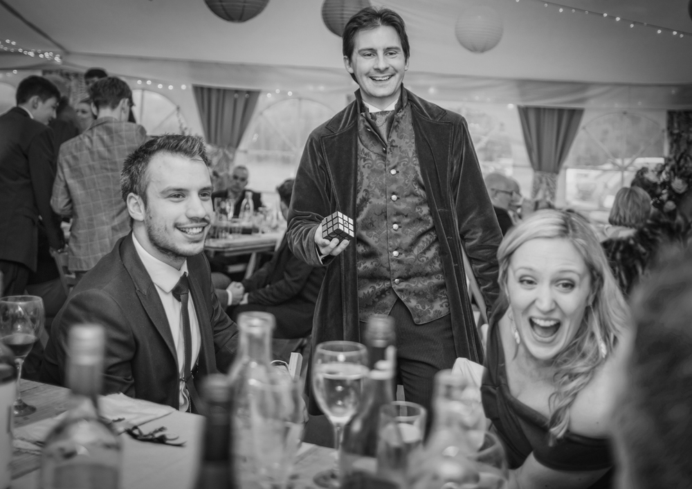 Wedding guests reacting positively to a magician