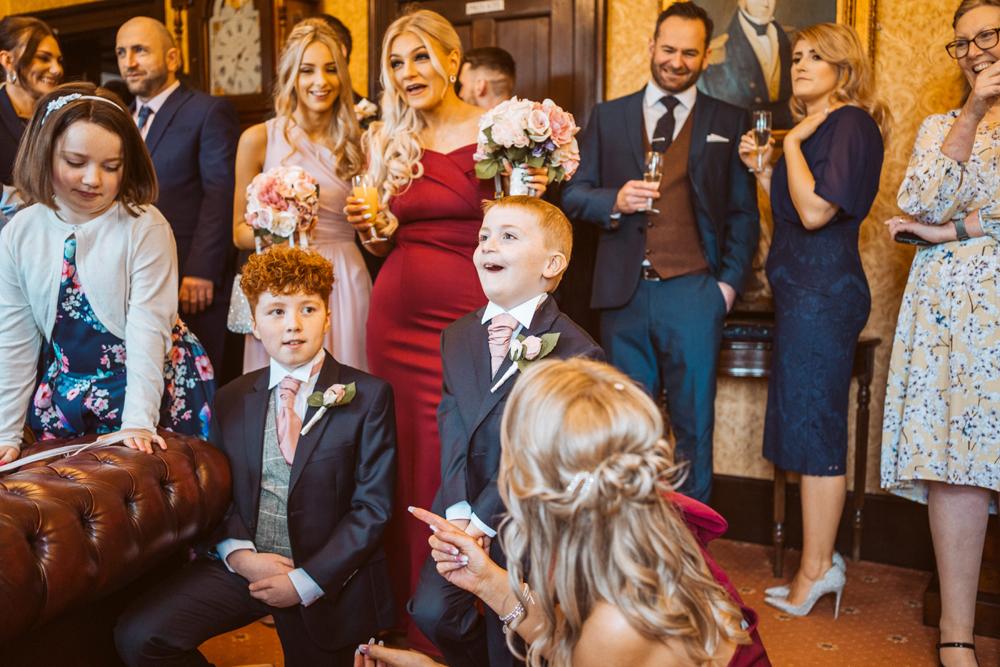 Children enjoying magic at a wedding