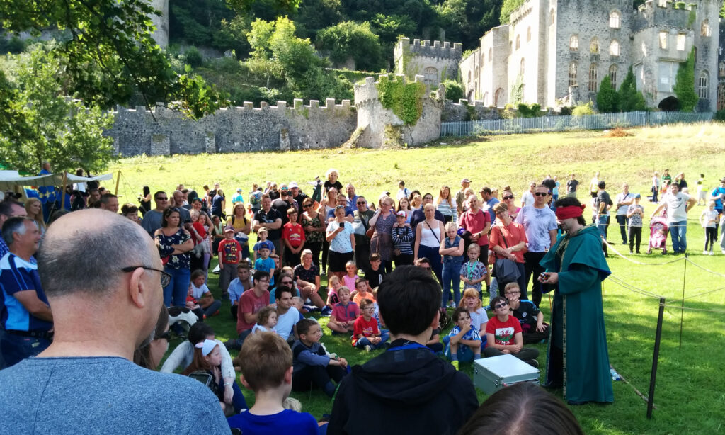 Jay Gatling at Gwrych Castle, North Wales.  Performing to a large group of people.