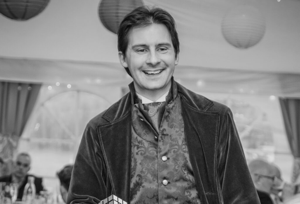 Black and white image of Jay Gatling, North Wales magician