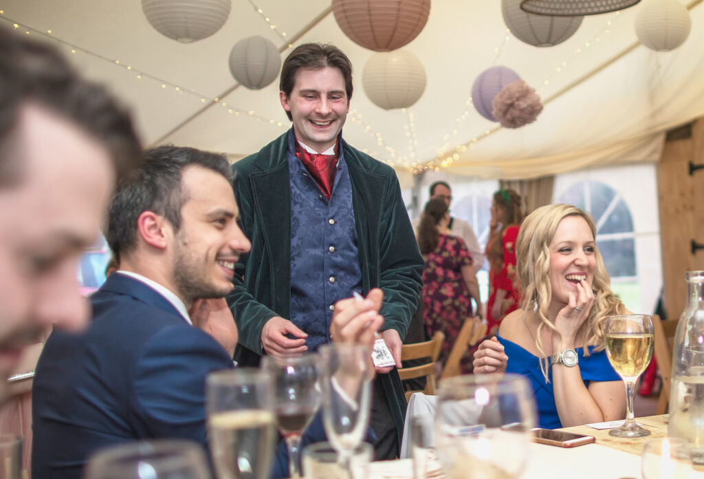 Wedding guests react to a magic trick from Jay Gatling