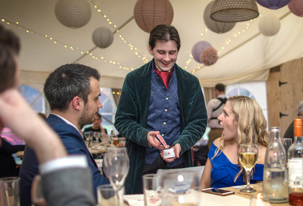 Magician Jay Gatling performs magic for amazed wedding guests in North Wales