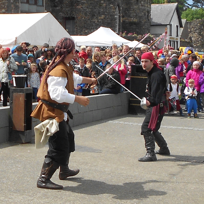 pirates swordfighting on conwy quay